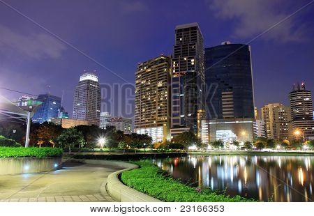 Buildings in the park at night in Bangkok, thailand