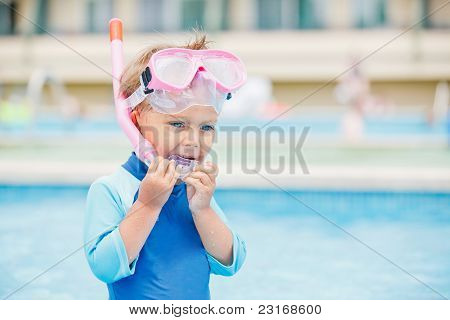 boy playing in a pool of water