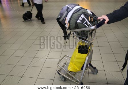 Hand Luggage On Cart In Airport
