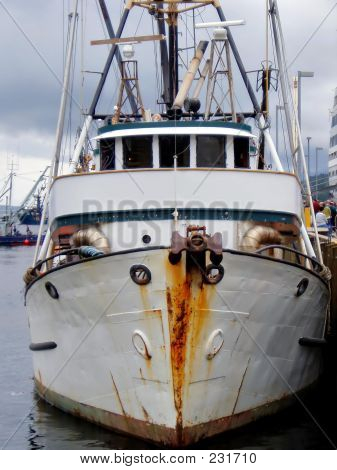 Rusting Fishing Boat In Alaskan Harbor