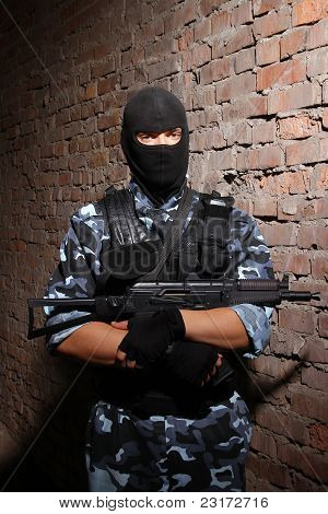 Soldier In Black Mask Holding A Gun