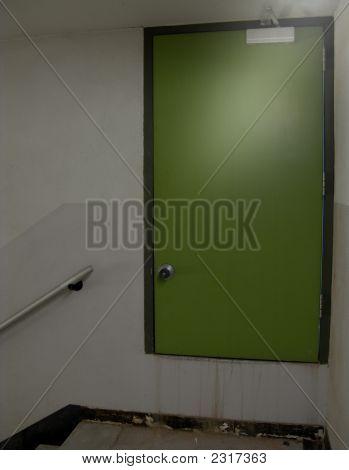Green Basement Door Exit From Dim Cellar