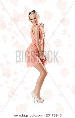Blond Beautiful Girl Standing Against White Background With A Attractive Pose With Bubbles Around