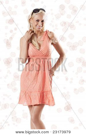 Blond Beautiful Girl Smiling And Standing Against White Background Between Some Soap Bubbles