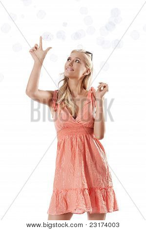 Blond Beautiful Girl Playing Against White Background Between Some Soap Bubbles