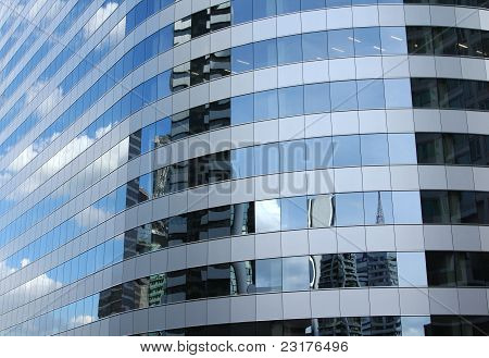 Reflex of sky on high-rise building