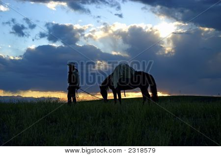 Cowboy With Pack Horse At Dawn