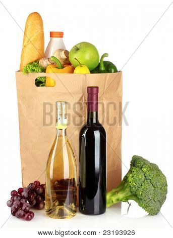 vegetables and wine in a paper bag isolated on white