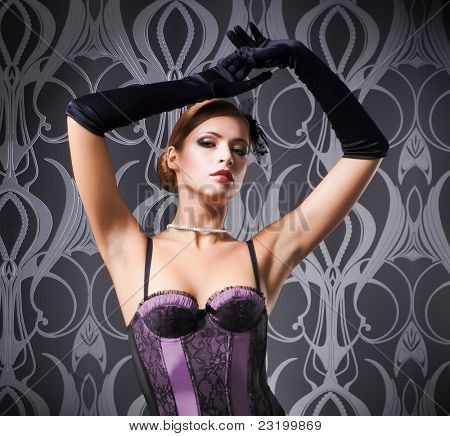 Young and beautiful redhead dancer over vintage background