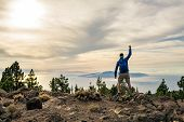 Man Celebrating Sunset Looking At View In Mountains. Trail Runner, Hiker Or Climber Reached Top Of A poster