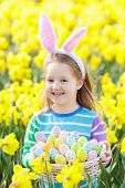 Child With Bunny Ears On Easter Egg Hunt poster