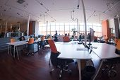 Group of Startup business people working everyday job at busy coworking office space poster