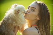 Woman Kiss Small Dog, Friend. Sensual Woman With Cute Spitz Puppy, Pet. Pet, Companion, Friend, Frie poster