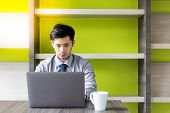 Portrait Working Handsome Man: Attractive Guy Is Doing His Work On Laptop. Charming Businessman Look poster