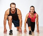 pic of fitness man body  - Athletic man and woman doing fitness exercise - JPG