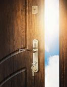 Half Open Door With Keys In Keyhole. Doorway To Heaven And Success. Entrance Or Exit, Dreams And Fre poster