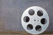 Old Motion Picture Film Reel On Colour Background poster