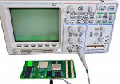 Oscilloscope And The Board On A White Background