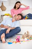 picture of untidiness  - Exhausted parents resting - JPG