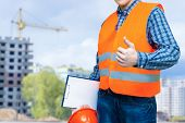 Builder Shows Quality Construction On Blurred Background . poster