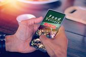 Hand Holding Smartphone To Order Food Delivery, Order Lunch Box Online Screen poster