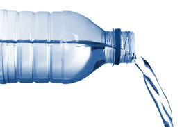 foto of bottle water  - isolated image of bottled water flowing from bottle - JPG