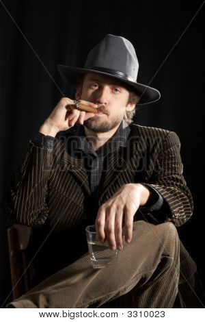 A Man With Glass Of Whiskey And Cigar