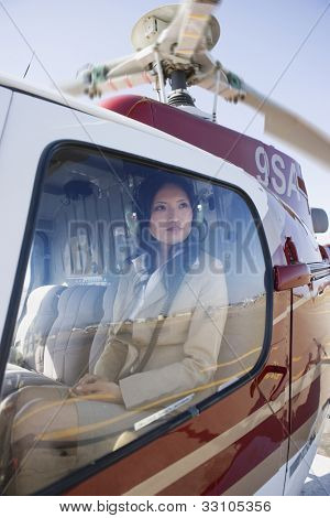Asian businesswoman in helicopter