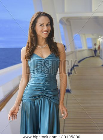 Hispanic woman in evening gown on ship