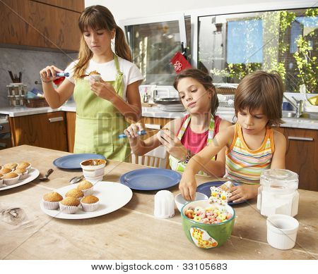 Hispanic sisters making cookies