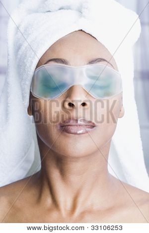 African American woman wearing gel eye mask