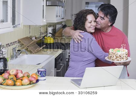 Senior Hispanic couple with birthday cake