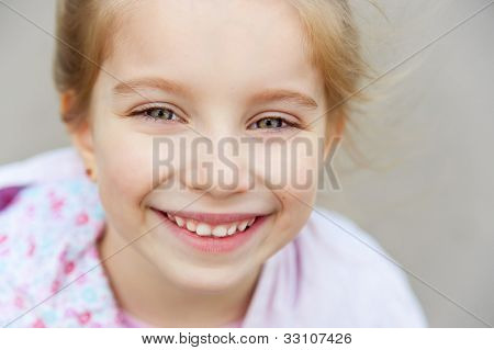 Portrait of a beautiful liitle girl close-up