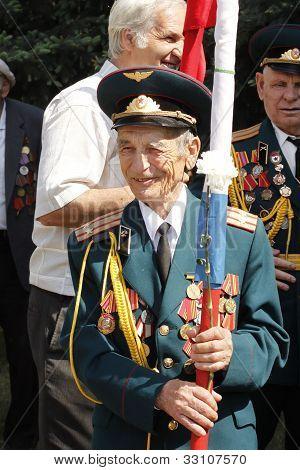 Soviet Army Veteran With Flag