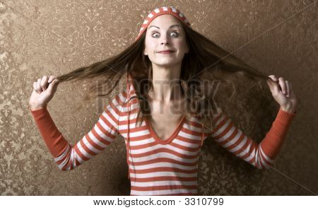 Young Woman Pulling On Her Long Hair