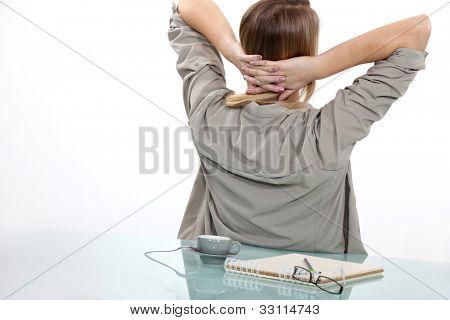 Woman taking a break from writing
