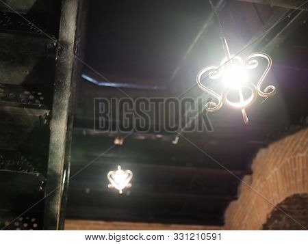 poster of Interior Design Of Lamp. A Light Bulb Is Illuminating And Hanging Under A House Roof. Lighting Lamp
