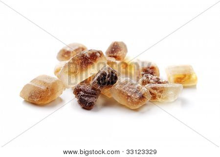 Crystals of Candi sugar / Rock sugar isolated on white with natural shadows.