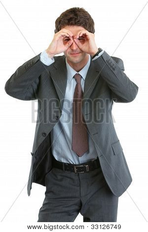 Modern Businessman Looking Through Binoculars Shaped Hands