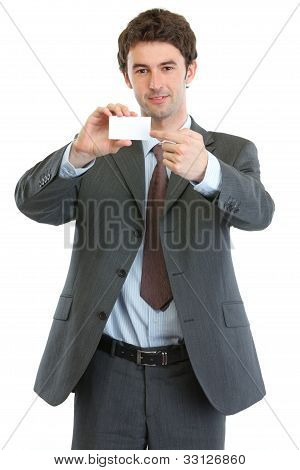 Modern Businessman Pointing On Blank Business Card