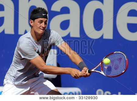 BARCELONA - APRIL, 24: Australian tennis player Bernard Tomic in action during his match against Ernests Gulbis  of Barcelona tennis tournament Conde de Godo on April 24, 2012 in Barcelona