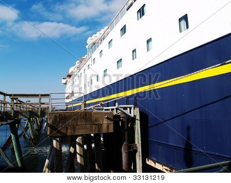 Starboard Side Of Large Ferry Tied To Pier