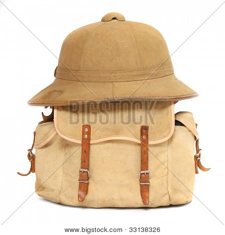 Vintage travel bag and tropical hat.
