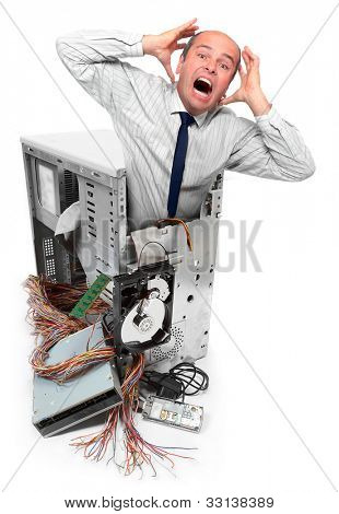 Computer crash and frustrated businessman. Information security concept.