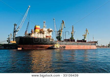 Big Ship Unloading In Shipyard