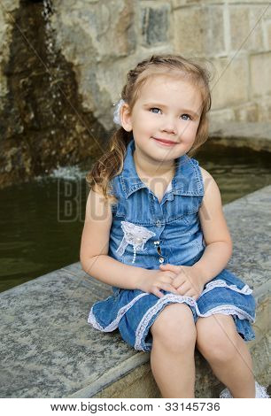 Portrait Of Cute Little Girl In Dress Outdoor