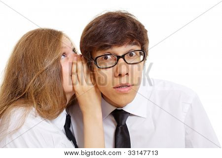 Teen girl tells something into guy's ear. Isolated on white background, mask included