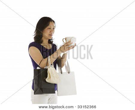 Women Inspecting New Coffee Mug