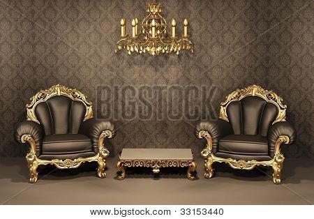 Sillones con marco de oro en el Interior viejo. Muebles de lujo. Apartamento de lujo