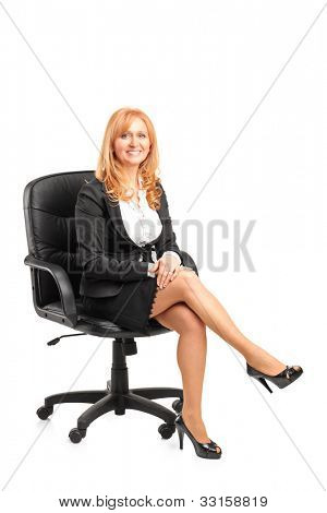 A portrait of a smiling  businesswoman sitting on a chair isolated on white background